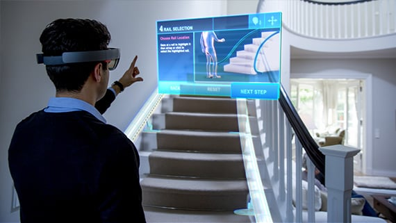 A thyssenkrupp Elevator technician uses Skype for HoloLens to get remote, hands-free access to technical and expert information while on site