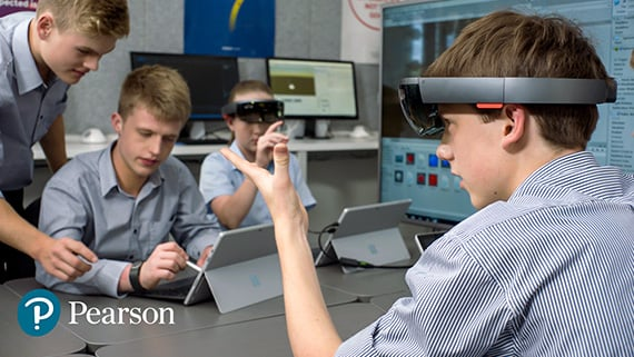 A high school student uses HoloLens during a classroom lesson
