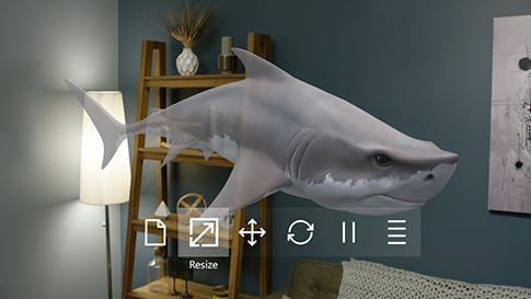 Viewed through 3D Viewer for HoloLens, a 3D model of a shark and a menu of controls are visible in a real-world room