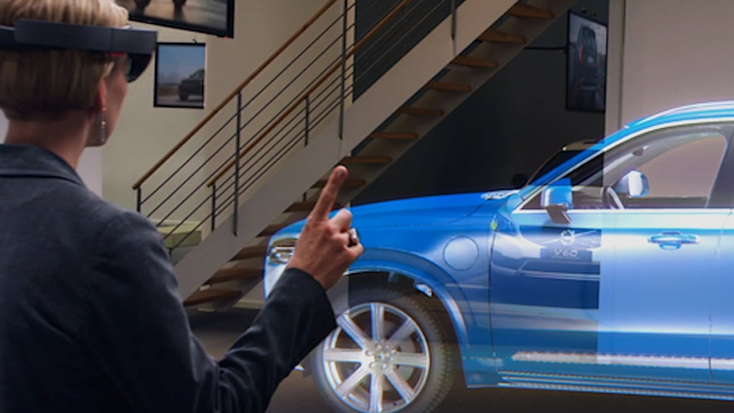 Wearing HoloLens, a Volvo employee uses gestures to work with a full-scale, holographic 3D model of a car