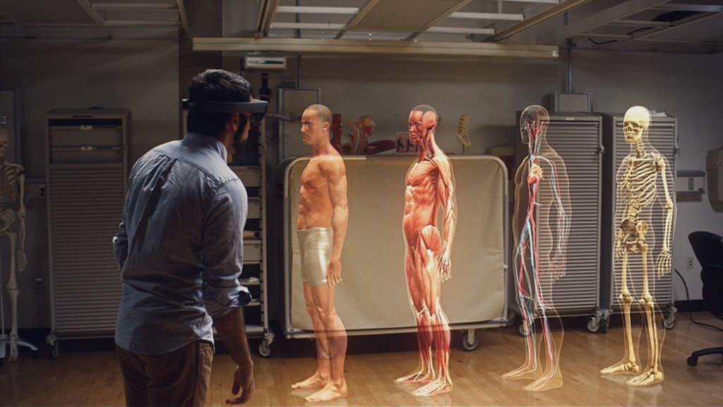 A medical student wearing HoloLens learns human anatomy using holographic 3D models