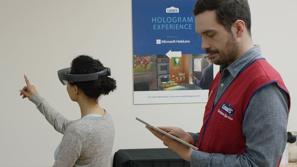 A Lowe's customer uses HoloLens to plan and visualize her home remodel