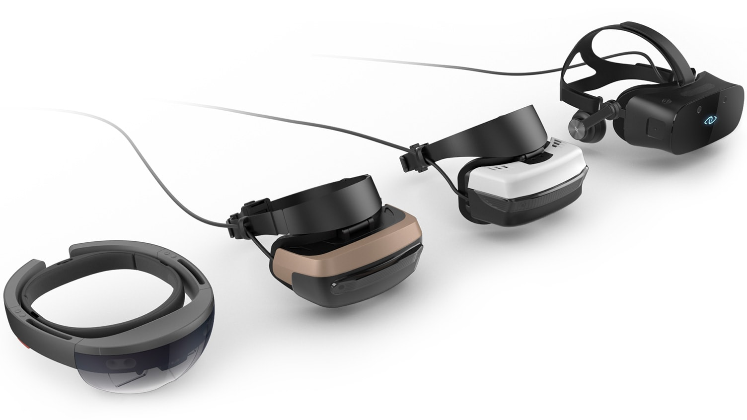 Several virtual reality and mixed reality headsets, including HoloLens, arranged side by side