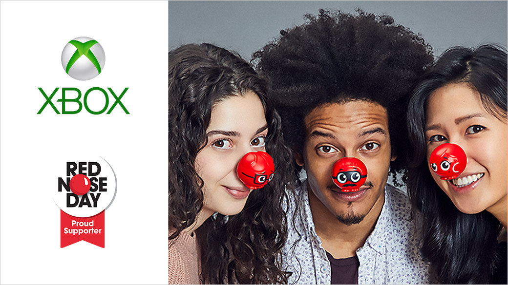 Xbox. Proud supporter, Red Nose Day. A trio of smiling people wearing red clown noses look into the camera.