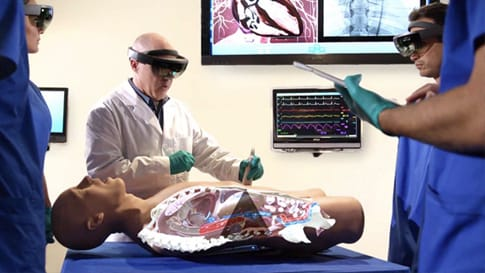 Medical students use HoloLens to examine a holographic model of a patient