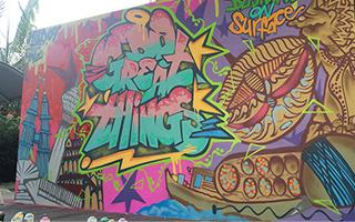 A colourful graffiti mural adorns a large wall